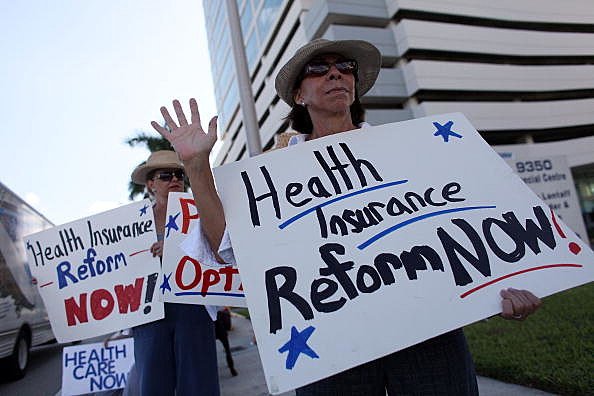 Activists Rally For Health Care Insurance Reform