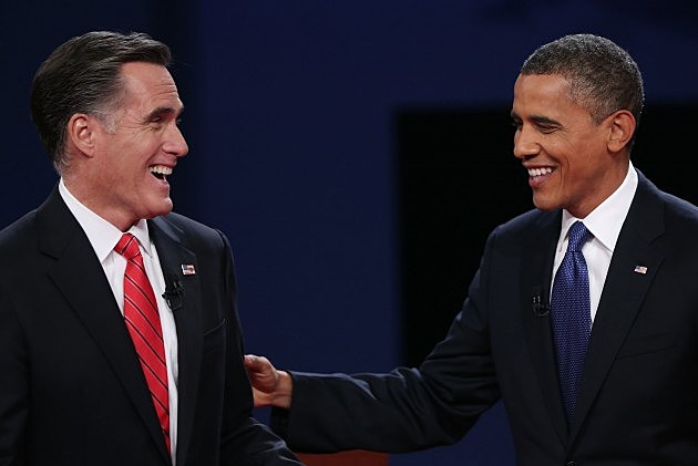 Former Governor Mitt Romney (L) and President Obama debate the issues in Denver, CO  (Photo by Win McNamee/Getty Images)