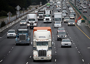 BERKELEY, CA - FEBRUARY 18: Trucks drive along Interstate 80 on February 18, 2014 in Berkeley, California. U.S. President Barack Obama announced that his administration is beginning to develop a new phase of tighter fuel efficiency standards for medium and heavy-duty vehicles and has ordered the Environmental Protection Agency and Transportation Department's National Highway Traffic Safety Administration to create and impose new fuel-efficiency and greenhouse gas standards by March 31, 2016. (Photo by Justin Sullivan/Getty Images)