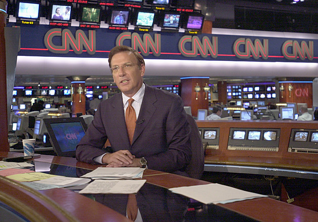 CNN Anchor Aaron Brown Delivers News