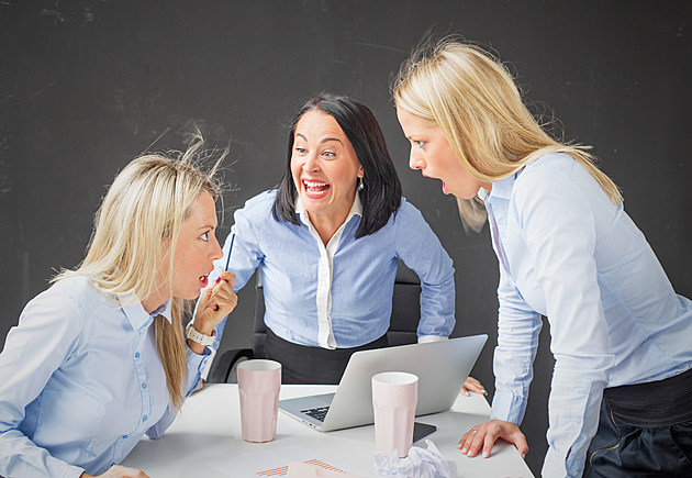 Women colleagues arguing and screaming in the office