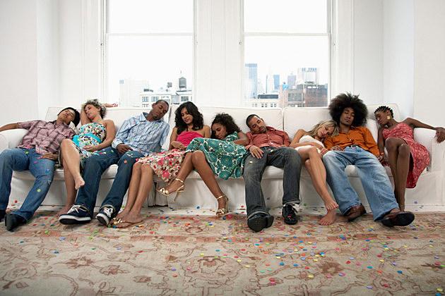 Group of Young People Sleeping on Sofa