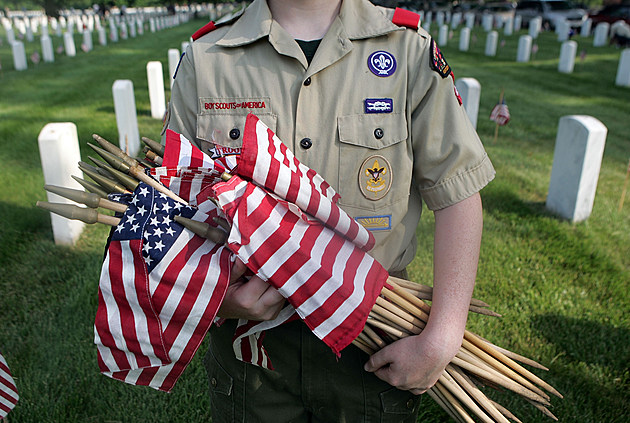 Boy Scouts Plant Flags At Cemetery For Memorial Day